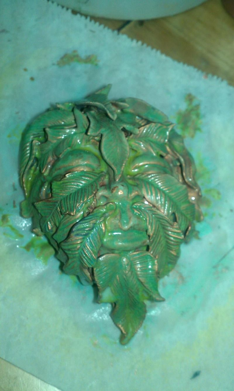 Greenman patina moments after spraying